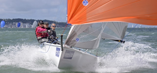 Julian Cooke going downwind at pace during Aberdeen Asset Cowes Week 2013. Photo Rick Tomlinson